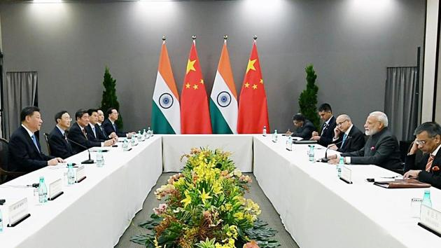 Prime Minister Narendra Modi meeting the President of the People's Republic of China, Xi Jinping, on the sidelines of 2019 BRICS Summit, in Brazil.(ANI Photo)