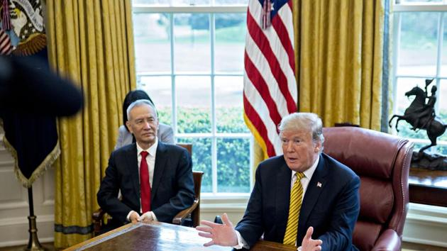 US President Donald Trump speaks as Liu He, China's vice premier, listens during a meeting in the Oval Office of the White House in 2019.(Bloomberg)