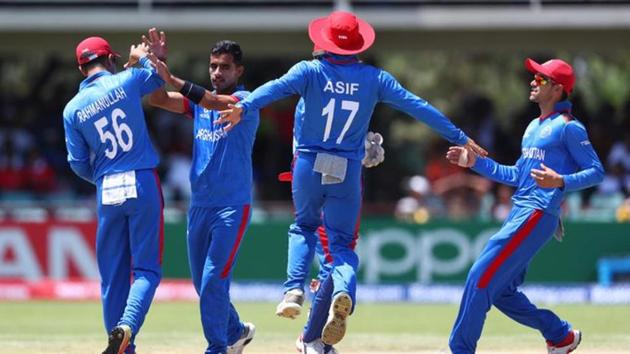 Shafiqullah Ghafari of Afghanistan celebrates with his teammates during the ICC U19 World Cup against South Africa.(Twitter/ICC)