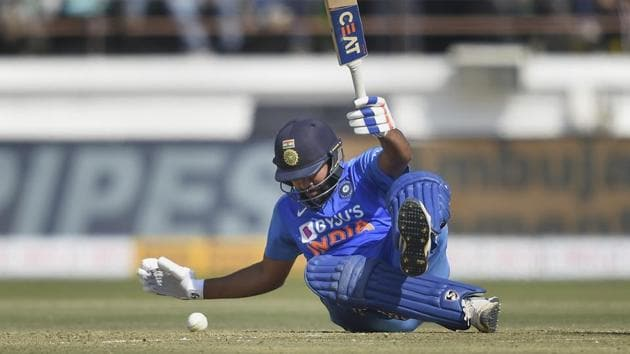 Rohit Sharma falls down after losing his balance during the second ODI.(PTI)