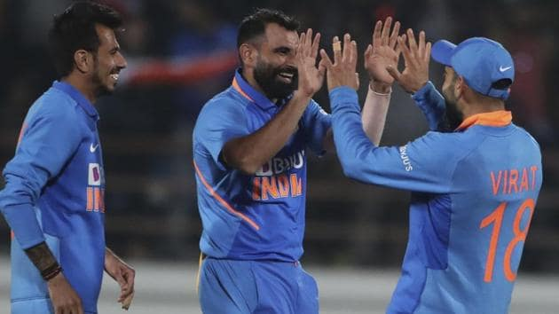 India's Mohammed Shami, second right, Yuzvendra Chahal, second left, Kedar Jadhav, left, and captain Virat Kohli celebrate.(AP)