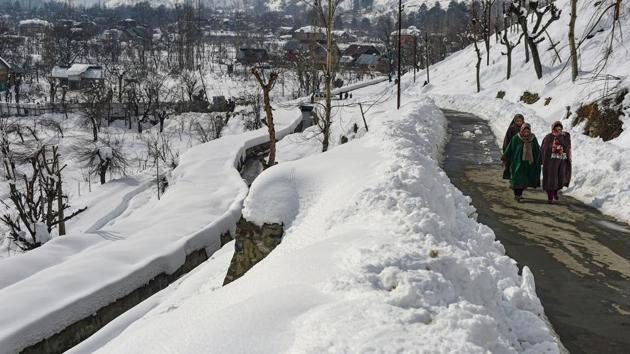 "Women walk on a road after heavy snowfall in Srinagar in Kashmir. Chief of Defence Staff (CDS) Gen Bipin Rawat had earlier said that de-radicalisation camps were operating in the country as ""it was necessary to isolate people who are completely radicalised"".(PTI)"