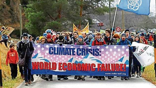 Climate activists start a hike to the Alpine resort of Klosters in Landquart, Switzerland, on Sunday.(Reuters)