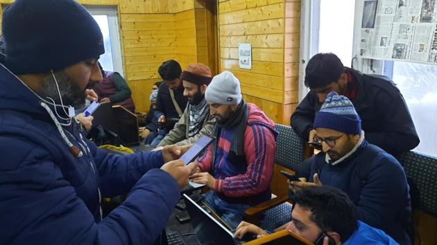 Media persons use internet facilities at the designated Media centre of the government's information department in Srinagar.(HT Photo)