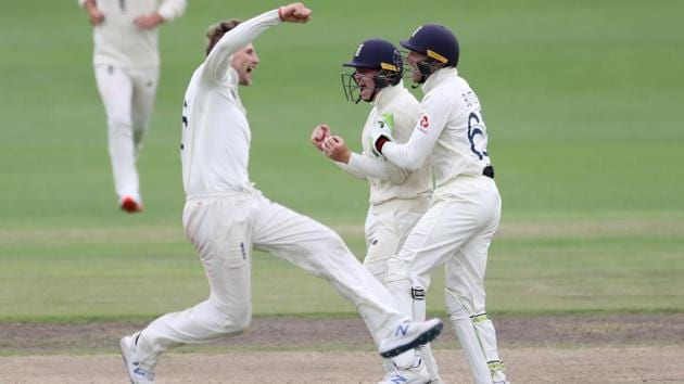 England's Ollie Pope celebrates taking the catch to dismiss South Africa's Rassie van der Dussen off the bowling of Joe Root.(REUTERS)