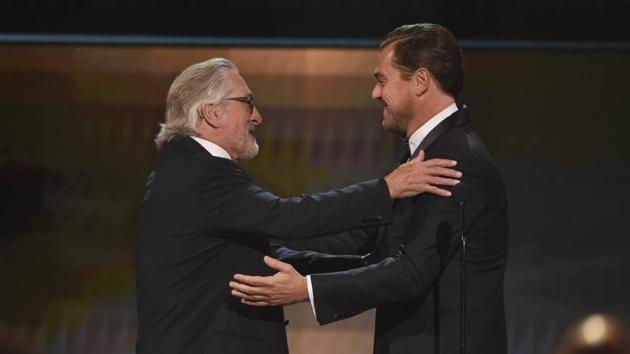 Leonardo DiCaprio, right, presents the lifetime achievement award to Robert De Niro at the 26th annual Screen Actors Guild Awards.(AP)