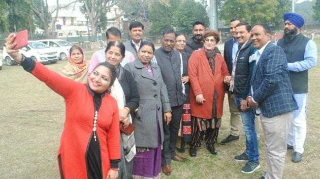 Mayor Raj Bala Malik along with councillors during her 'welcome party' at Rose Club in Sector 16, Chandigarh, on Monday.