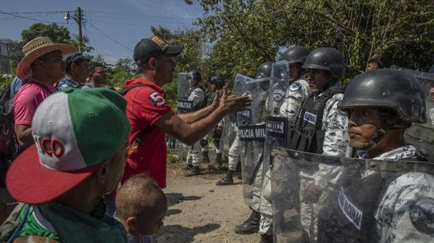 When Mexican officials denied free entry passage, the migrants went down to the Suchiate River where hundreds forded its shallow waters and soon faced guardsmen.(Bloomberg Image)