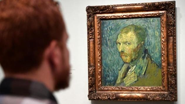 A man looks at Dutch post-impressionist painter Vincent van Gogh's self portrait, painted during a psychotic episode, at the Van Gogh Museum in Amsterdam, Netherlands January 20, 2020.(REUTERS)