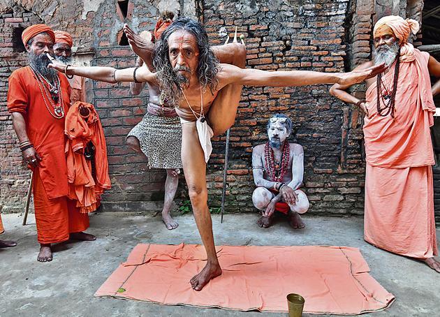 The right balance: Sadhus marking International Yoga Day at Kamakhya Temple in Guwahati, Assam, on June 21, 2018.(Biju Boro/AFP)