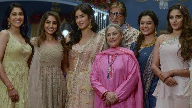 """Amitabh Bachchan poses on sets with the """"ladies at work""""."""
