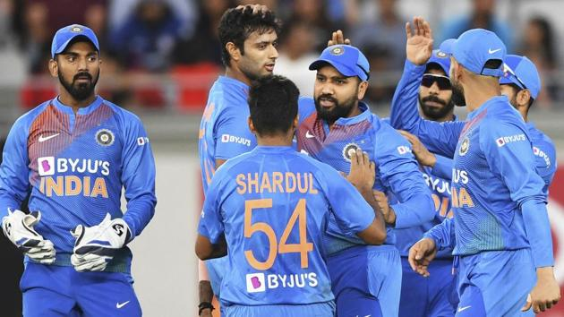 Auckland: India's Rohit Sharma is celebrated after taking a catch to dismiss New Zealand's Martin Guptill.(AP)