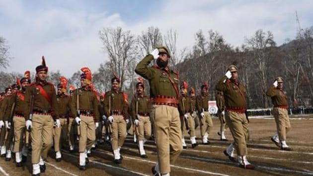 Jammu and Kashmir Police march past during full dress rehearsal for the Republic Day parade at Sher-e-Kashmir Stadium, in Srinagar. It has swept the bravery awards for police forces this year.(HT Photo)