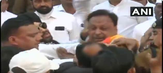 Screengrab of Devendra Singh Yadav and Chandu Kunjir slapping each other at Indore on Sunday.(ANI)