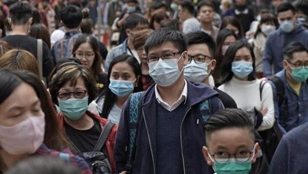 People wear masks on a street in Hong Kong.(AP)