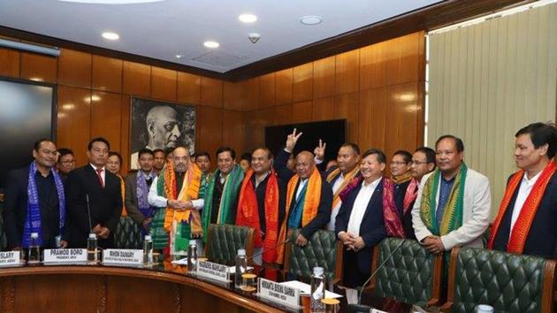 Home Minister Amit Shah during the signing of the accord with Assam CM Sonowal, minister HB Sarma and Bodoland stakeholders.(Twitter/@narendramodi)