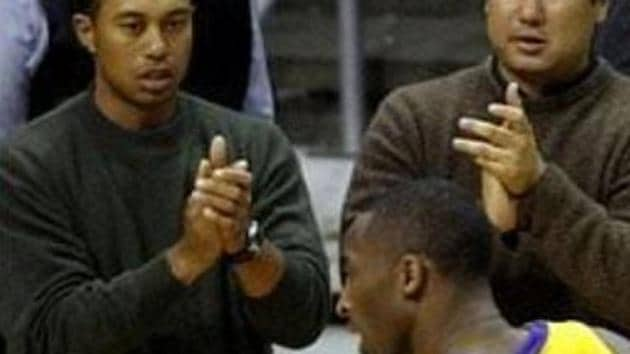 File photo of Tiger Woods cheering Kobe Bryant from the sidelines.(Twitter)
