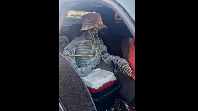The skeleton was tied to the seat with rope and had a hat on to make it look more believable.(Twitter/@Arizona_DPS)