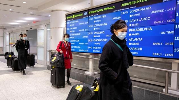 Flight crew members wear masks at Pearson airport arrivals, shortly after Toronto Public Health received notification of Canada's first presumptive confirmed case of coronavirus, in Toronto, Ontario.(REUTERS)