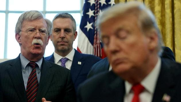 """FILE PHOTO: U.S. President Donald Trump listens as his national security adviser John Bolton speaks during a presidential memorandum signing for the """"Women's Global Development and Prosperity"""" initiative in the Oval Office at the White House in Washington, U.S., February 7, 2019. REUTERS/Leah Millis/File Photo(REUTERS)"""