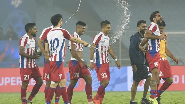ATK players celebrate after wining against North East United FC during ISL match at Salt Lake Stadium in Kolkata.(PTI)