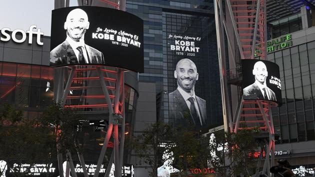 Electronic signs honor Kobe Bryant at LA Live in Los Angeles on Sunday.(AP)