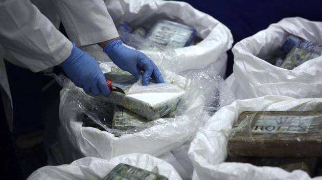 A member of the police opens a packet with cocaine.(AP/Representative Picture)