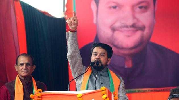 Minister of State for Finance and Corporate Affairs Anurag Thakur addresses an election campaign ahead of the forthcoming Delhi Assembly elections, at Rithala, in New Delhi.(HT Photo)
