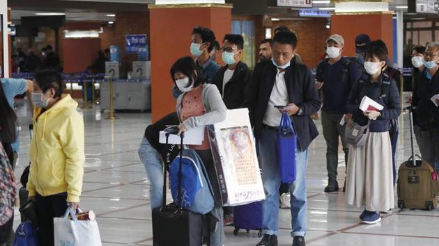 Wuhan Coronavirus: Passengers wearing face masks arrive at Tribhuwan International airport in Kathmandu, Nepal.(AP)