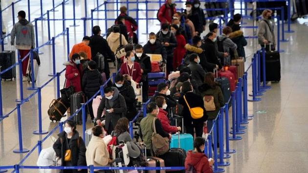 Passengers wearing masks are seen at the Pudong International Airport in Shanghai, China January 27, 2020.(REUTERS)