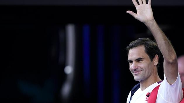 Switzerland's Roger Federer waves as he leaves the court after winning his match against Tennys Sandgren of the U.S.(REUTERS)