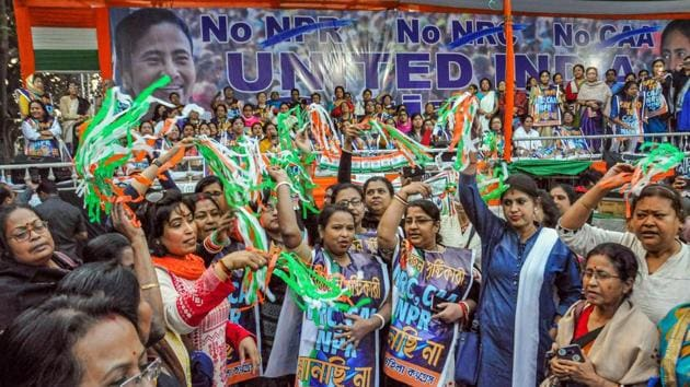 Trinamool Mohila Congress activists celebrate after a resolution was passed against the Citizenship Amendment Act (CAA) in its assembly, in Kolkata.(PTI)