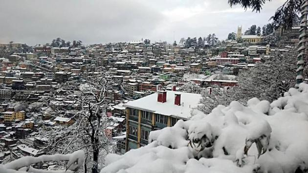 A picturesque view of Shimla town after fresh snowfall on Wednesday.(ANI Photo)