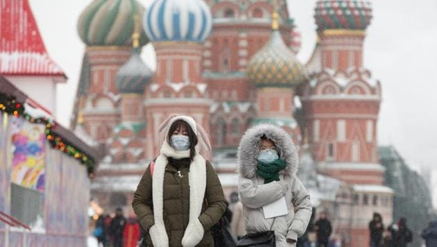 Tourists wear protective face masks as they walk in Red Square near the Kremlin in Moscow, Russia, on Tuesday, Jan. 28, 2020. The outbreak of the deadly coronavirus threatens to derail a fragile stabilization in the world economy, which had appeared poised to benefit from the phase one U.S.-China trade deal, and signs of a tech turnaround.(Bloomberg)