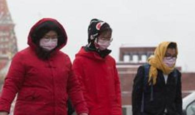 In the picture, tourists are seen wearing protective face masks. Prime Minister Imran Khan already directed a high level meeting of stakeholders to make plans to deal with any emergency.(Bloomberg FILE)