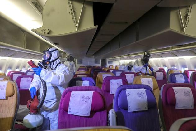 Members of the Thai Airways crew disinfect the cabin of an aircraft of the national carrier during a procedure to prevent the spread of the coronavirus at Bangkok's Suvarnabhumi International Airport on January 28/(Reuters)