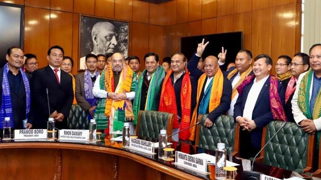 Union Home Minister Amit Shah presides over the signing of a historic agreement to end the over 50-year old Bodo crisis, in New Delhi.(PTI)
