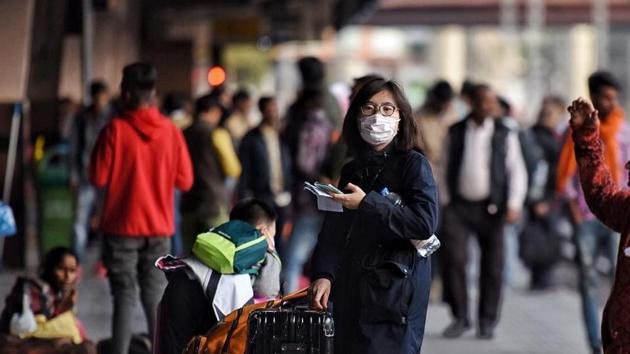 Tourists cover their face with masks in light of novel coronavirus scare as Jaipur health department is on alert, at Jaipur Railway Station, Rajasthan, India, on January 28, 2020.(Raj K Raj / Hindustan Times)