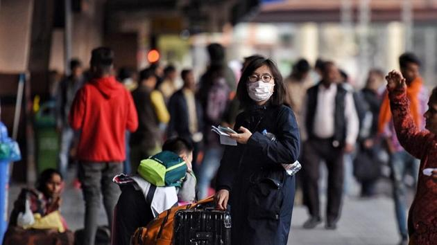 Tourists cover their face with masks in light of novel coronavirus scare as Jaipur health department is on alert, at Jaipur Railway Station, Rajasthan, on January 28, 2020.(Photo by Raj K Raj / Hindustan Times)
