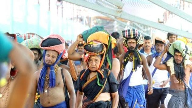 A woman is seen among the crowd of devotees at the Pamba base camp of Sabarimala Temple.(Photo: Vivek R Nair/ Hindustan Times)
