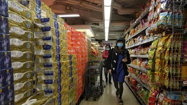 People wear face masks at a supermarket in Hong Kong on Wednesday. A viral outbreak that began in China has infected more than 6,000 people in the mainland and more than a dozen other countries.(AP Photo)