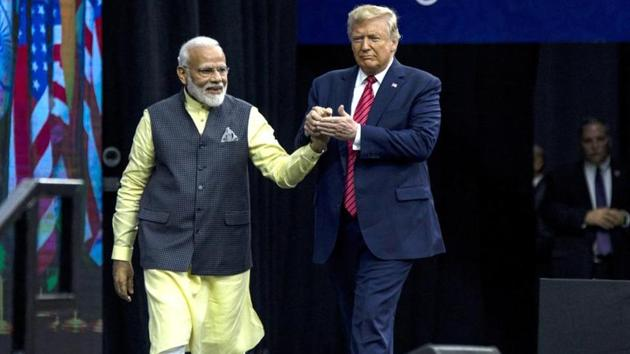 PM Narendra Modi and US President Donald Trump hold hands on stage during the Howdy Modi Community Summit in Houston, Texas on Sept. 22, 2019. Trump is also likely to receive a grand welcome during his forthcoming visit to India.(Bloomberg via Getty Images/File)