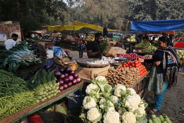 A women shops for vegetables at a market in Prayagraj, India.(AP)