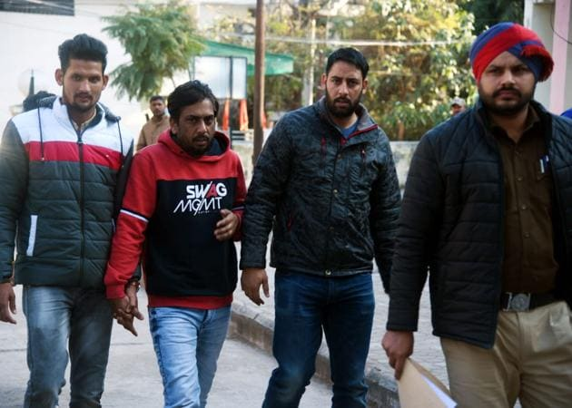 Accused Rakesh Verma (centre) in police custody outside Dera Bassi court on Thursday.(HT PHOTO)