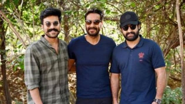 Ram Charan, Ajay Devgn and Jr NTR pose together.(Twitter)