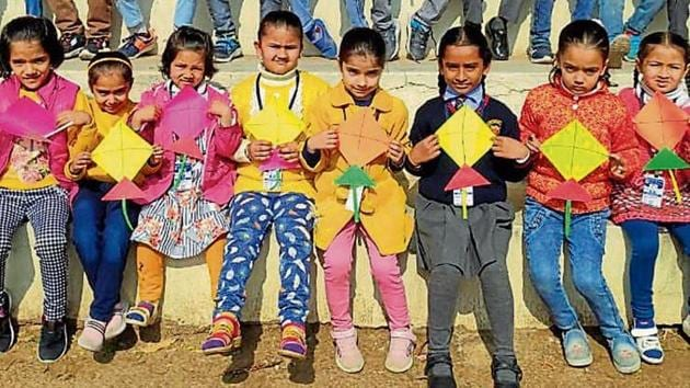 Students of DC Model Senior Secondary School with their kites.(HT)