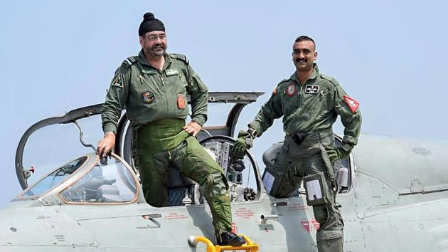 Air Chief Marshal BS Dhanoa and Wing Commander Abhinandan Varthaman after a sortie on the MiG 21 jet, at Airforce Station, Pathankot.(PTI)