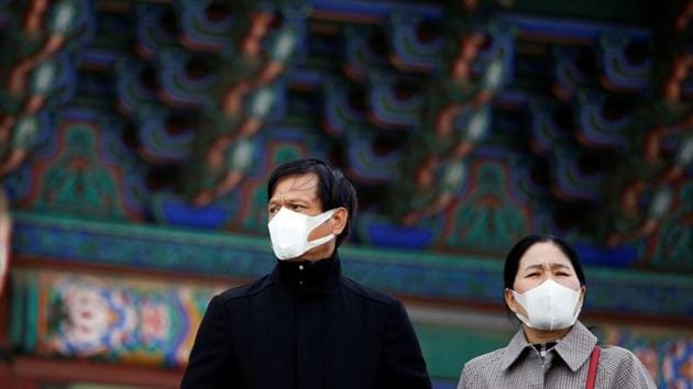 A couple wear masks to prevent contracting coronavirus in Seoul, South Korea.(REUTERS)