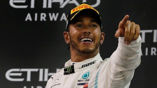 Mercedes' Lewis Hamilton celebrates with a trophy after winning the race.(REUTERS)
