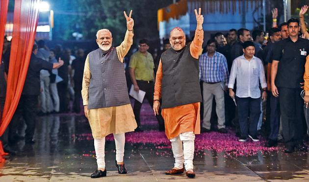 PM Narendra Modi and current Minister of Home Affairs, Amit Shah, in New Delhi on May 23, 2019, celebrating the BJP's victory in the 2019 general elections.(Money Sharma/AFP)